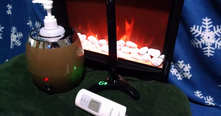 Heated Blanket, Lube Warmer, and Fleshlight sleeve warmer in front of a fire.